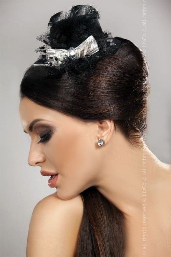 Livia Corsetti Black Mini Top Hat with Silver Bow Fascinator model 16